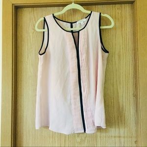 Light pink blouse with pleat and black detail